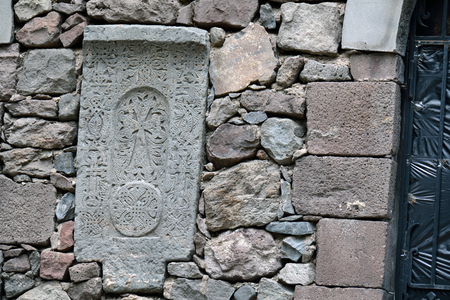 geghard: The carved hachkar (cross on the stone) embedded to the wall of Geghard monastery, Armenia Stock Photo