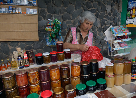 armenian woman: An old woman selling jams, wine and honey in the Armenian market