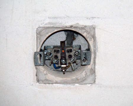 Dismantled socket on the wall ready for works Stock Photo