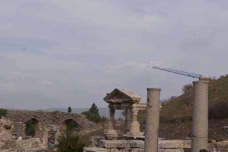 reconstructing: View of the street in Ephesus, with the crane reconstructing the city in the far