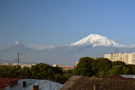 aras: Roofs of Yerevan city with Ararat in the far