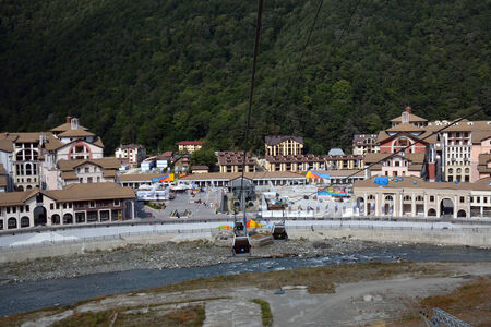 gorki: Buildings in the embankment of Mzymta river, Sochi, Russia, with the cabins below