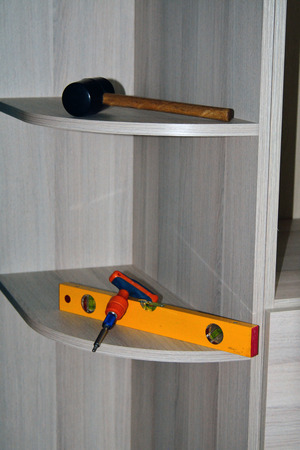 leveling instrument: Furniture and tools for assembly on the shelves