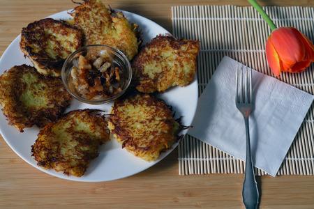hashbrown: thin brown potato pancakes on the plate closeup Stock Photo
