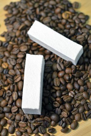pastila: Long vanilla pastille (sort of marshmellow) on coffee beans closeup