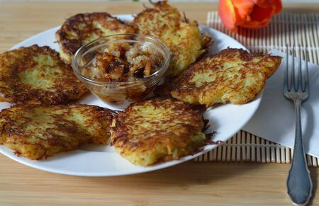 hashbrown: plate of thin brown potato hashbrown pancakes with onion and lard Stock Photo