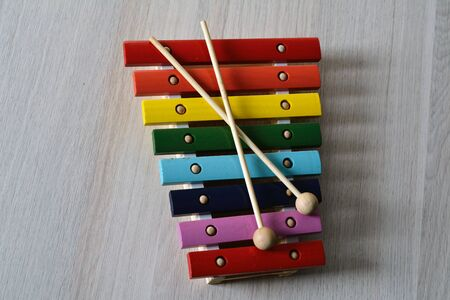 xylophone: bright multicored xylophone with crossed sticks Stock Photo