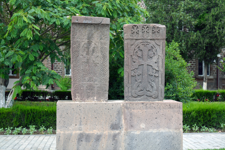 Two grey carved khachkar stones, in Echmiadzin, Yerevan