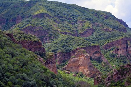 geghard: high mountains next to Azat river and Geghard monastery, covered with greenery, in Armenia