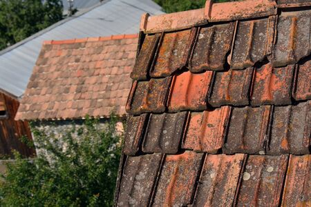 gables: Roofs with old red tiles, Armenia Stock Photo