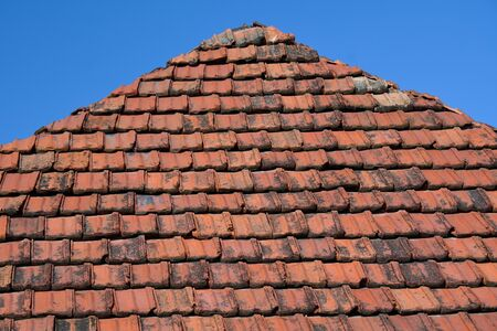 Part of the roof with old red tiles, Armenia