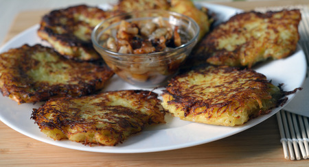 hashbrown: potato pancakes (hashbrown) on the white plate closeup