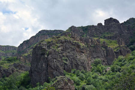 geghard: mountains in Armenia, surrounding Geghard monastery, with a cross Stock Photo