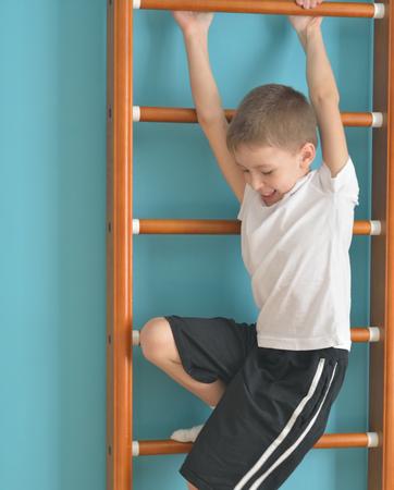 upward struggle: boy jumping off the ladder