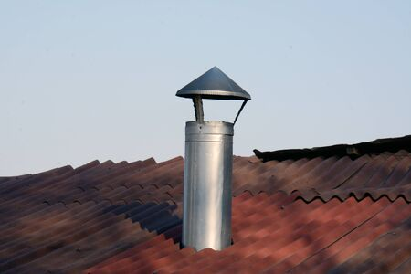 metal chimney and part of the tile roof