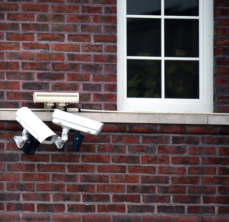 several: several CCTV cameras on the wall outdoors Stock Photo