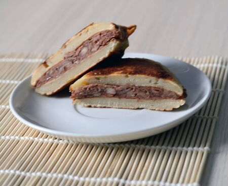 confectionary: sweet honey fried confectionary dorayaki, cut into two