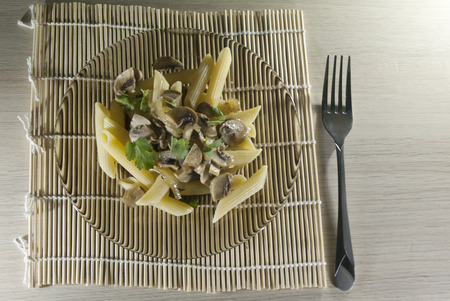 flavorsome: Penne rigato with mushrooms on the plate Stock Photo