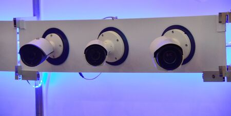 three cctv cameras on the wall ready for the show Stock Photo