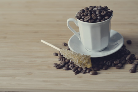 coffee beans put in a cup, with sugar