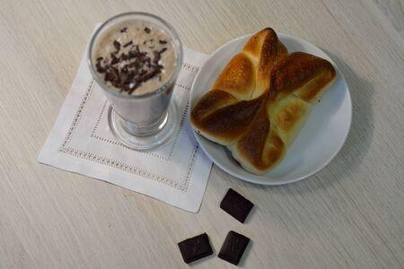 chocolate cocktail and a bun, selective focus
