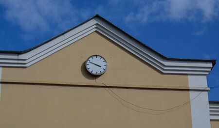 Part of the building with the clock shown