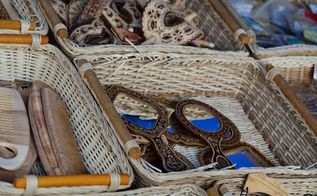 souvenirs: wooden and leather traditional souvenirs in the baskets for sale Stock Photo