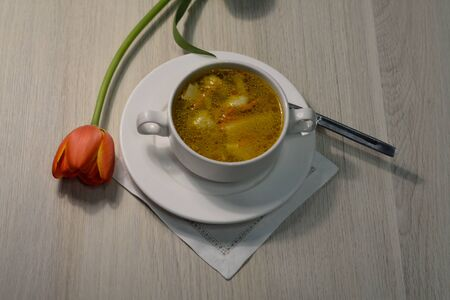 bowl of potato soup with chicken on the table