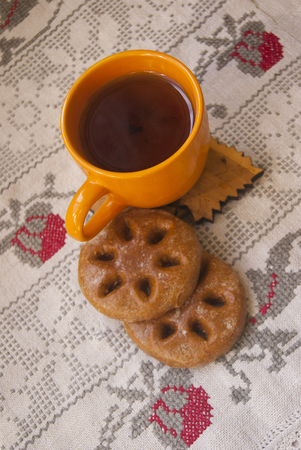 Cup of hot tea with round cookies on a towel Stock Photo