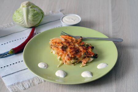 sour cream: spicy cabbage casserole, served with sour cream