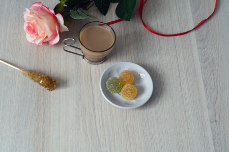 marmelade: white coffee with fruit marmelade on the table