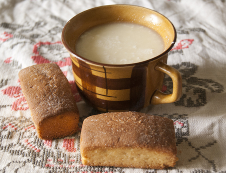 sour milk: cup of sour milk amd fresh biscuits on a traditional embroidered towel Stock Photo