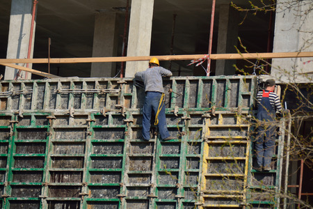 staging: PODOLSK, 28.04.2015 workers making staging on the building