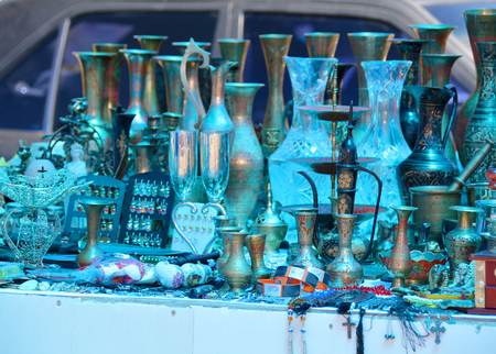 antiquities: Various souvenirs for sale on a market, blue toned Stock Photo