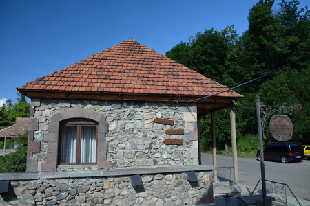 Small house in Dilijan, with arrows pointing to Tuffakian carpet museum