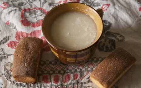 sour milk: two soft biscuits with some sour milk on a towel Stock Photo