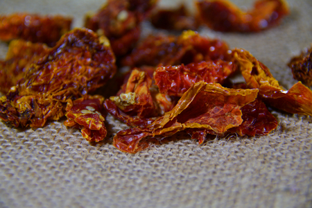 sack cloth: Dried tomato pieces in a pack on sack cloth