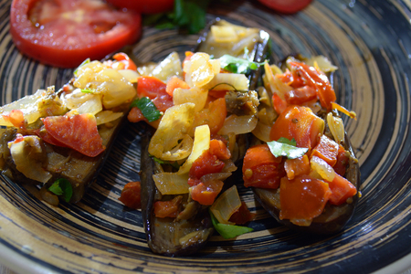 imam: Imam bayildi - eggplant with onions, tomatoes and greenery on the plate
