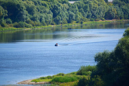 river boat: banks of Oka river with a small boat