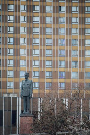 charles de gaulle: MOSCOW, RUSSIAN FEDERATION - 14.04.2015: monument to Charles de Gaulle in winter, with Cosmos hotel as a background