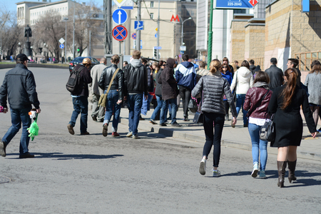 scramble: MOSCOW, RUSSIAN FEDERATION - 11.04.2015: people crossing the street next to the metro station, in spring