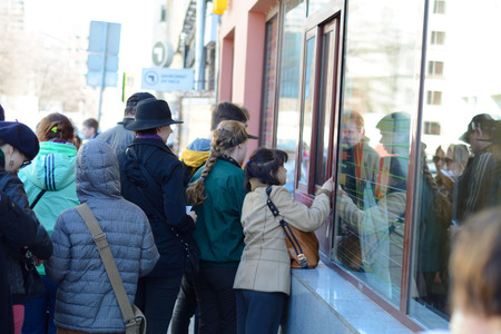 macdonald: MOSCOW, RUSSIAN FEDERATION - 11.04.2015: people buying food in Macdonalds  fast food restaurant, from the window