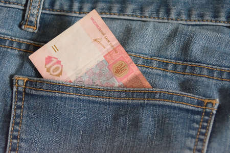 shown: Ten hryvnias note in the jeans pocket, partly shown