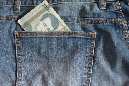 armenian: Banknote with 1000 Armenian dram in pocket of jeans