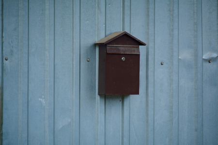 metal post: metal post box on the corrugated fence