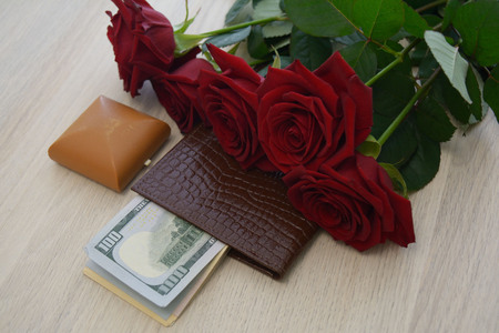 jewellery box: red roses, jewellery box, and dollard in the wallet Stock Photo