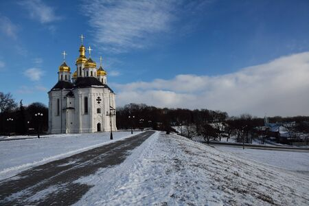 catherine: winter park in Chernihiv with Catherine church and the alley Stock Photo