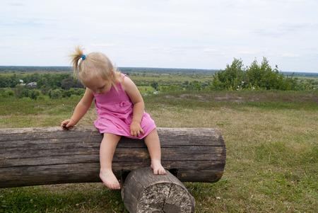 explores: small child explores the log