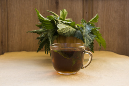 herbal tea with nettle, on the table