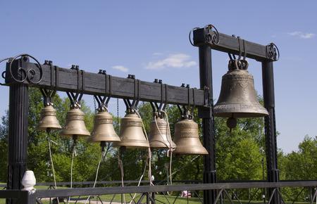 Bells in a set next to Podolsk church, in summer